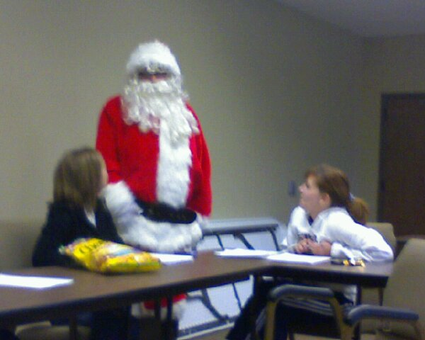 Santa visits staff meeting...